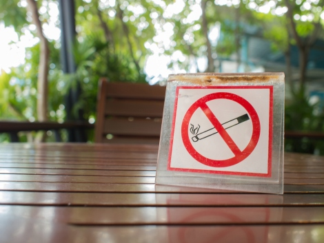 No smoking sign displayed on the wooden table